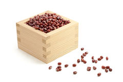 Red beans in Japanese sake cup called Masu Royalty Free Stock Photo
