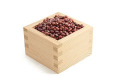Red beans in Japanese sake cup called Masu Stock Image