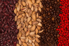 Red beans, pistachios, roasted coffee beans and dried rowan berries. Different colors of healthy food. Territory taste. Grains, kernels and berries Royalty Free Stock Photos