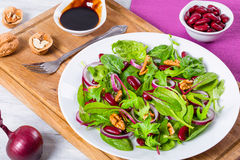 Red beans salad with mix of lettuce leaves and walnuts Stock Photos