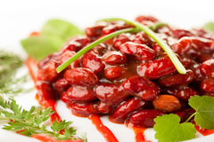 Red beans in tomato sauce on a dish. Closeup shot with shallow focus Royalty Free Stock Photos