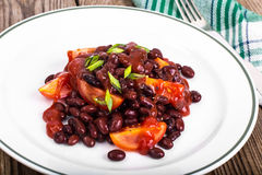 Red beans, tomatoes, ketchup, onion and spices on the white plat Royalty Free Stock Image