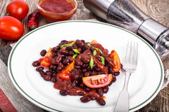 Red beans, tomatoes, ketchup, onion and spices on the white plat Stock Image