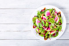 Red beans, watermelon radish , lettuce leaves, walnuts salad, cl Stock Photo