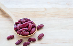 Red beans in wooden spoon Stock Photos