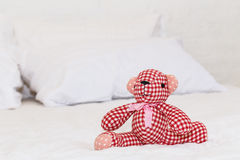 Red bear doll on bed Royalty Free Stock Photos