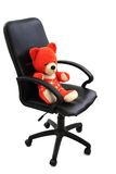 Red bear toy in the office chair Stock Photography