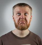Red-beard man looking up with discontent Royalty Free Stock Images