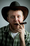 Red-bearded man in a cowboy hat and a shirt. With a cigar in his mouth Stock Photos