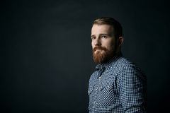 Red bearded man studio portrait on dark background Royalty Free Stock Images