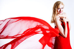 Red, beautiful blonde in a red dress Stock Photo