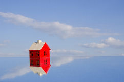 Red beautiful house symbol model on mirror Royalty Free Stock Image
