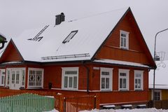 Red beautiful house in winter background royalty free stock photo
