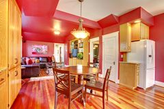 Red beautiful large kitchen with cherry hardwood. Royalty Free Stock Photo