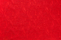 Red beautiful ornate paisley ethnic fabric. Stock Photography