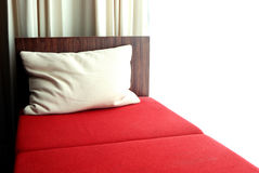 Red bed in the bedroom Royalty Free Stock Photos