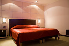 Red bed in room. Red bed in hotel room Stock Photography