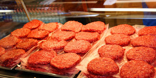 Red beef burger for sale by the butcher Stock Image