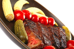 Red beef meat served with corns Royalty Free Stock Photos