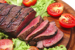 Red beef meat on wooden plate royalty free stock image
