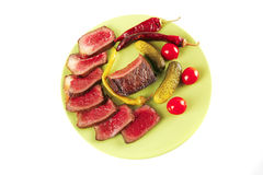 Red beef slices on green dish Royalty Free Stock Photos