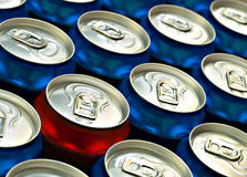 Red beer can standing out from the croud. Of Blue beer cans Stock Image