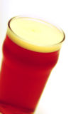Red beer. With foam in glass isolated on white royalty free stock photos