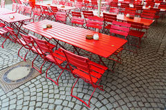 Red beer garden tables Royalty Free Stock Photos