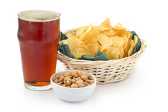 red beer peanuts and chips Royalty Free Stock Photography