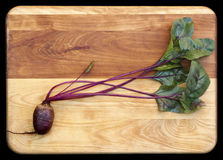 Red Beet on Cutting Board Stock Image