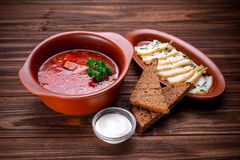 Red beet soup (borsch) with bread and sour cream Royalty Free Stock Images