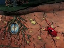 Giant red beetle with black spot on the back sculpture in the Park Jaime Duque stock photo