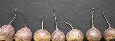Red beetroot on black surface, overhead view. stock image
