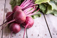 Red Beetroot with herbage green leaves on rustic background. Org Royalty Free Stock Image