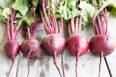 Red Beetroot with herbage green leaves on rustic background. Org Royalty Free Stock Photo