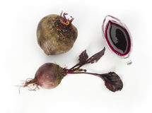 Red beets with leaves and jug with juice Stock Images
