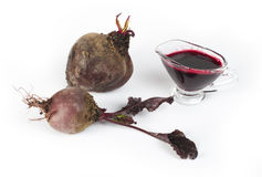 Red beets with leaves and jug with juice Stock Photo