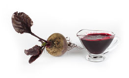 Red beets with leaves and jug with juice Royalty Free Stock Photo