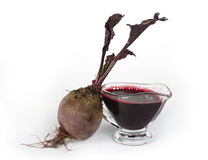 Red beets with leaves and jug with juice Royalty Free Stock Photography