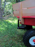 Red and beige wagon. On green gass with plenty of room for text royalty free stock photography
