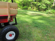 Red and beige wagon. On green gass with plenty of room for text stock photo