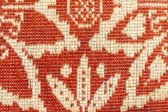 Red beige wool fabric with a pattern stock image