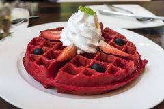 Red belgium waffle topped with fresh strawberry blueberry Stock Image