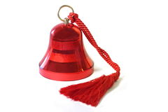 Red Bell. A bright red bell isolated on white Stock Images