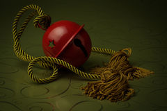 Red Bell with gold rope Stock Images