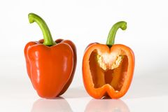 Red bell pepper. On high key background cutin hafe Royalty Free Stock Photography
