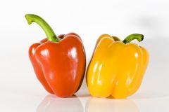 Red bell pepper. Red and yellow bell pepper on high key background Royalty Free Stock Photography