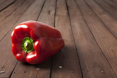 Red bell pepper on brown table Royalty Free Stock Photos