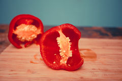 Red bell pepper on chopping board Stock Photography