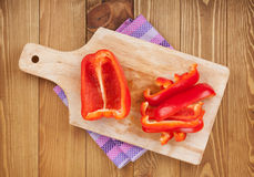 Red bell pepper on cuting board Stock Images